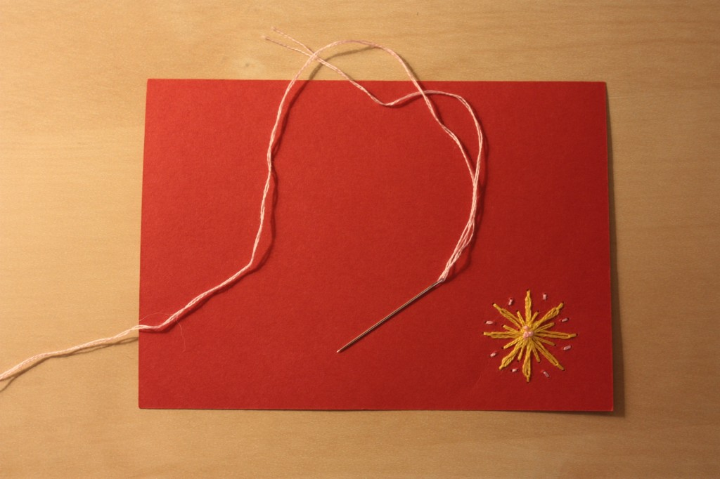 Orange card with yellow embroidery